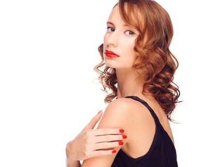 Portrait of young beautiful woman with red lipstick and hairstyle. Isolated on white background photo