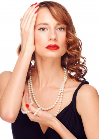 Portrait of beautiful elegant woman with red lipstick and beautiful pearl necklace. Isolated on white background photo