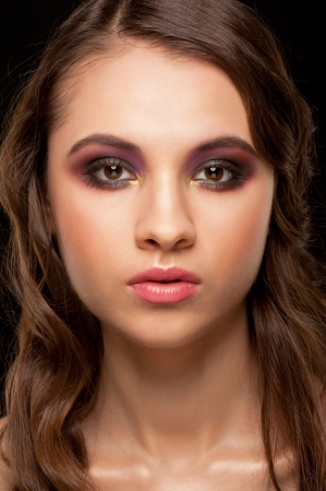 Portrait of attractive young woman with stylish bright makeup  photo