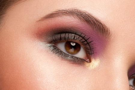 Closeup shot of beautiful woman eye with bright fashion makeup photo