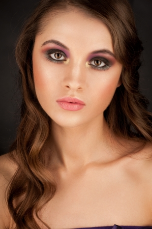 Portrait of attractive young woman with stylish bright makeup  Stock Photo - 17255273
