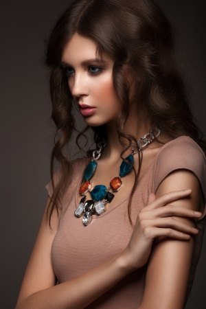 Portrait of attractive young woman with beautiful necklace Stock Photo - 17255260