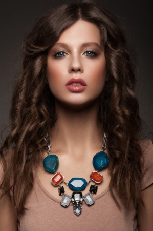 Portrait of attractive young woman with beautiful necklace photo