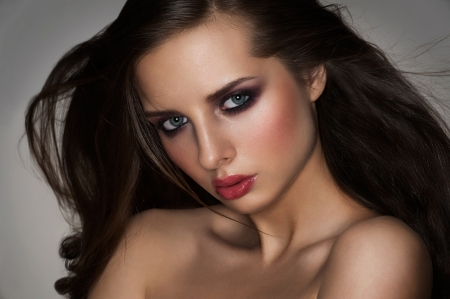 Portrait of attractive young woman with trendy makeup photo