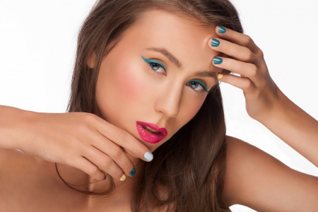 Portrait of attractive young woman with colorful makeup and manicure, isolated on white background photo