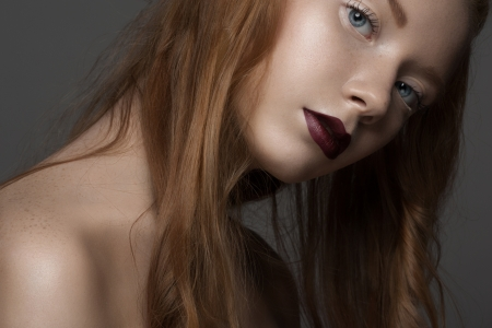 Portrait of attractive young woman with bright lipstick and long red hair Stock Photo - 17255263