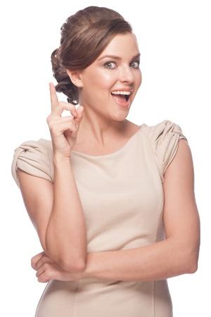 boca abierta: Retrato de una mujer joven pensativa con la boca abierta hacia arriba. Aislado sobre fondo blanco.