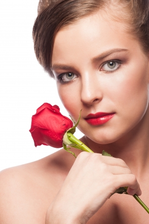 Portrait of elegant beautiful woman with red lipstick holding red rose. Isolated on white background photo