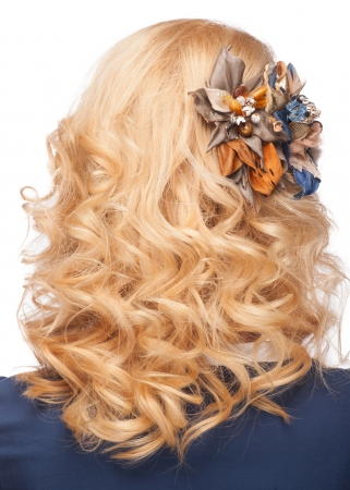 Woman with curly blond hair with beautiful hairstyle and stylish hair decoration. Isolated on white background Stock Photo - 19980136