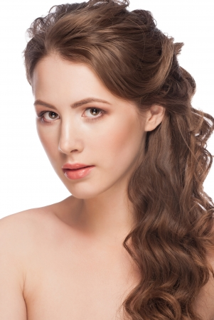 Portrait of Beautiful Caucasian Woman with Long Brown Curly Hair. Bridal hairstyle, isolated on white background  photo