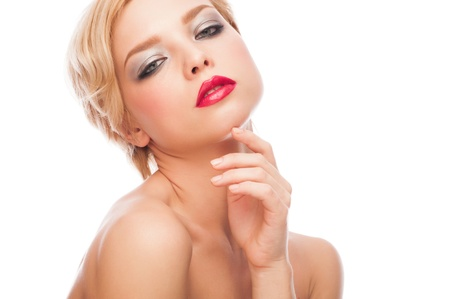 Portrait of attractive young woman with red lipstick and  short blond hair photo