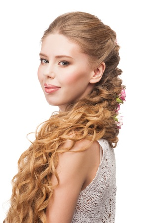 Blond Hair. Beautiful Caucasian Woman with Curly Long Hair and Makeup. Bridal hairstyle