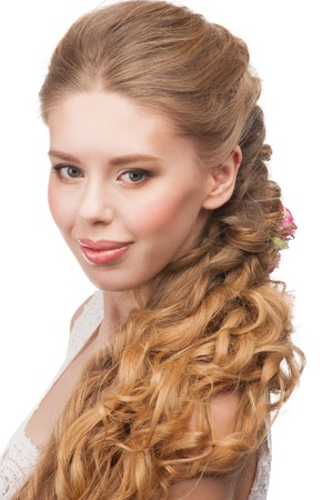 Blond Hair. Beautiful Caucasian Woman with Curly Long Hair and Makeup. Bridal hairstyle  photo