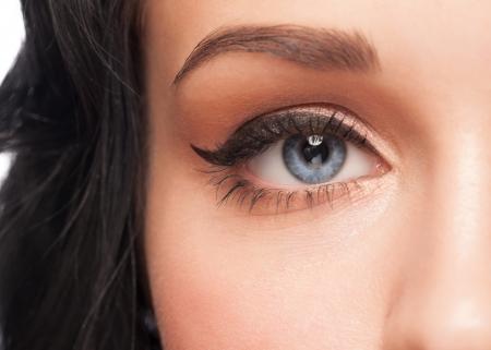 Closeup shot of beautiful woman blue eye with bright stylish makeup  Stock Photo