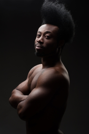 manful: Portrait of handsome young african american man with stylish hairstyle and with a muscular   torso