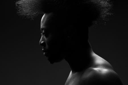 manful: Portrait of handsome young african american man with stylish hairstyle Stock Photo