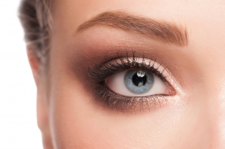 Close-up image of beautiful woman blue eye with bright fasion makeup  photo