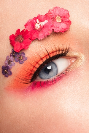 Close-up image of woman eye with bright creative makeup  photo