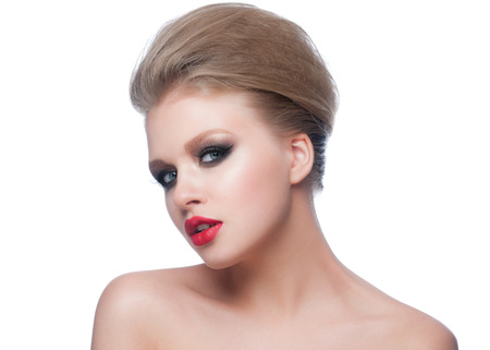 Portrait of beautiful young woman with stylish bright makeup and updo hairstyle. Woman with red lips photo