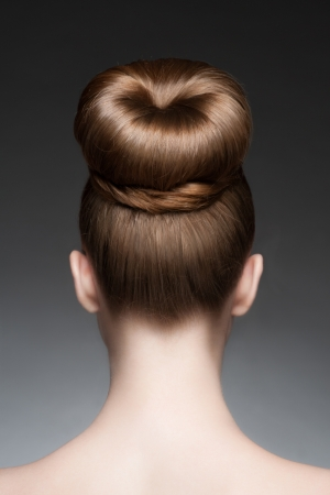 hair: Portrait of young beautiful woman with creative elegant hairstyle, hair bun. Rear view