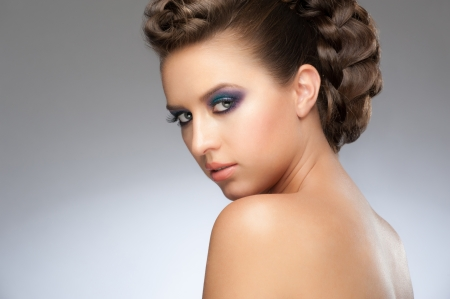 Portrait of beautiful young woman with fashion makeup and beautiful hairstyle photo