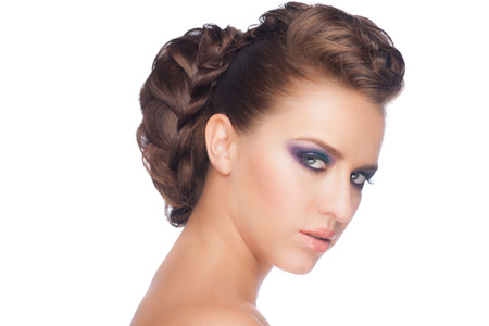 Portrait of pretty young woman with fashion makeup and beautiful braid hairstyle  photo