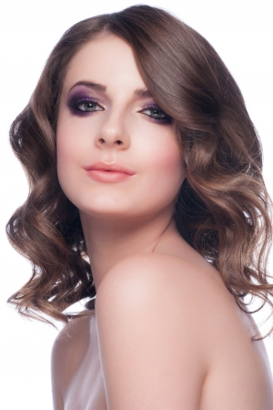 Studio portrait of young beautiful woman with stylish makeup and hairstyle photo
