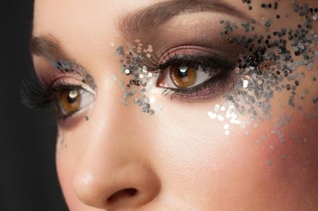 fancy girl: Eye Makeup. Closeup of Beautiful Woman Eye with Glitter Makeup. Fancy Makeup, False Eyelashes