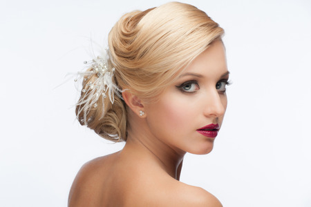 nude bride: Portrait of a pretty young girl with a beautiful vintage hairstyle and makeup, wedding style