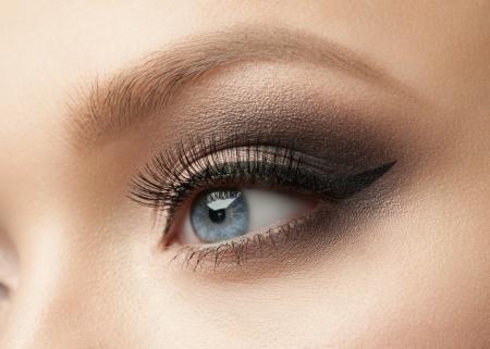 optician: Closeup of beautiful woman eye with makeup, eyeliner