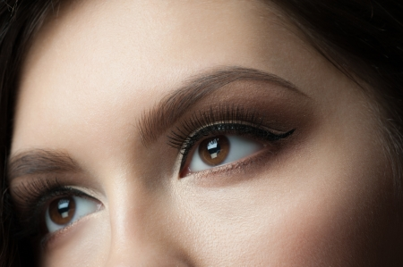 Closeup of beautiful woman eye with makeup, looking up Banque d'images