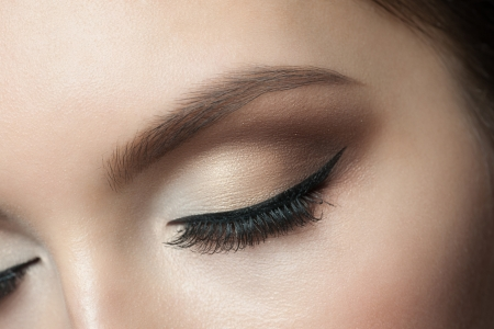 Closeup of beautiful woman eye with makeup, closed eyes photo