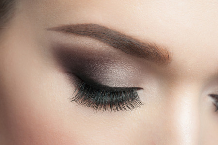 Closeup of woman eye with beautiful makeup with long eyelashes Banque d'images