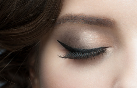 Closeup of woman eye with beautiful makeup with black eyeliner Stock Photo