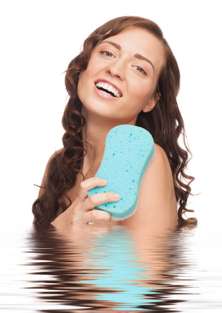 bast: Portrait of young beautiful woman in water washing with blue bath sponge. Isolated on white background Stock Photo