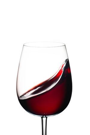 shot glass: Red wine splash, over white background