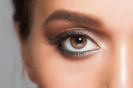 young eyes: Closeup of beautiful woman eye with stylish bright makeup, macro Stock Photo