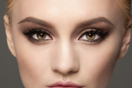 Closeup image of beautiful woman eyes with fancy bright makeup. Makeup with eyeliner and falce eyelashes Stok Fotoğraf