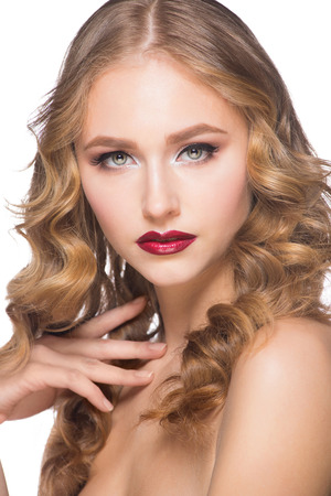 Portrait of attractive young caucasian woman with stylish makeup and wavy hairstyle photo