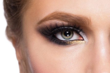 Closeup image of beautiful woman eye with fashion makeup. photo