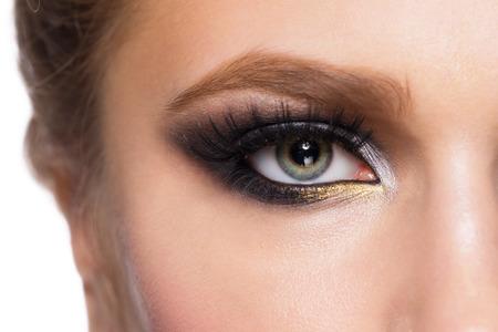 Closeup image of beautiful woman eye with fashion makeup. photo