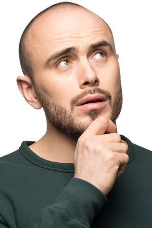 stubble: Portrait of young man being doubtful about something