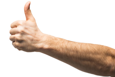 man arm: Male hand showing thumbs up sign against white background