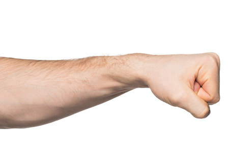 assault forces: Hand with clenched a fist, isolated on a white background