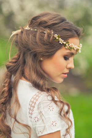 hair braid: Beautiful Girl in spring garden. Girl with golden tiara on her head, spring time.