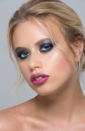 nude blonde girl: Portrait of attractive young caucasian woman with stylish blue makeup