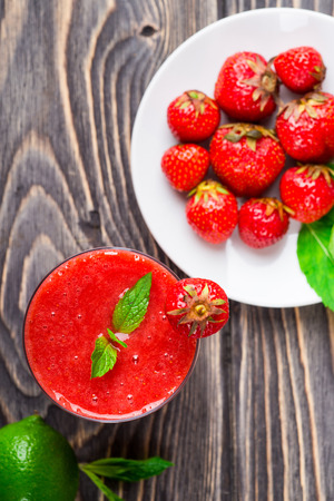 strawberry smoothie: Strawberry smoothie with fresh berries on wooden background Stock Photo