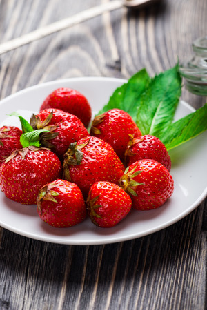 sappy: Fresh Red Strawberry with mint on white plate Stock Photo