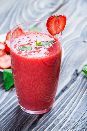 Strawberry smoothie with fresh berries on wooden background Stock Photo