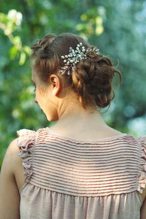 tress: Portrait of girl with beautiful updo hairstyle with tress in summer garden, summertime Stock Photo